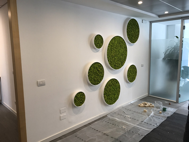 Office Wall Design in Corian® with Vertical Green