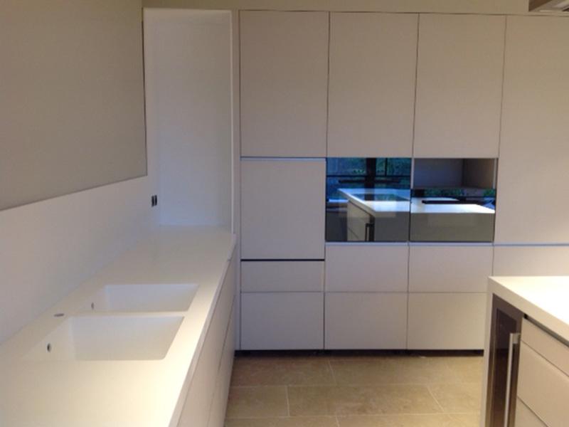 Piano cucina in corian bianco andreoli corian solid surfaces - Piano cucina in corian prezzi ...